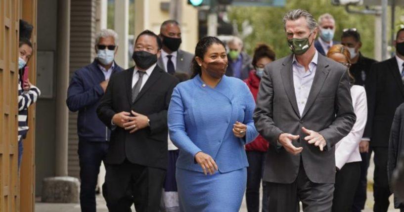 California Gov. Gavin Newsom is seen walking with San Francisco Mayor London Breed on Geary Street in a photo taken on June 3, 2021.
