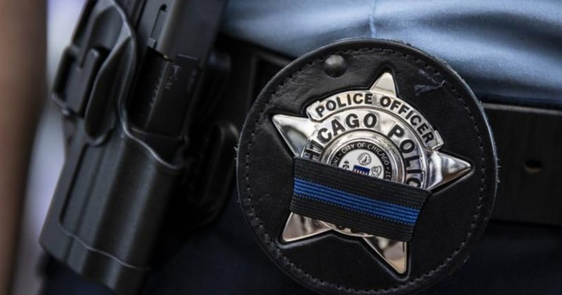 A photo taken on Tuesday shows a police officer's badge as the cop wearing it walks into the Leighton Criminal Courthouse in Chicago.