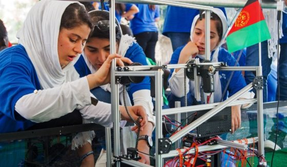 The Afghan all-girls robotics team works with a robot during the First Global Challenge at the DAR Constitution Hall in Washington on July 17, 2017.