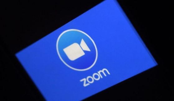 The Zoom logo is depicted in a photo taken on March 30, 2020, in Arlington, Virginia.
