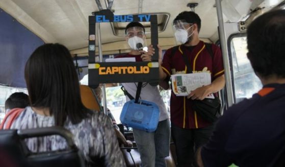 Journalists are seen standing on a bus in Caracas, Venezuela in a photo taken on Saturday.