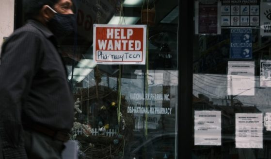 """A """"help wanted"""" sign in the Queens borough of New York City is depicted in a photo taken on June, 4, 2021."""