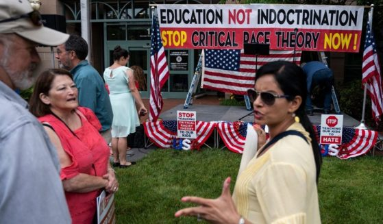 People talk at a rally against critical race theory in Leesburg, Virginia, on June 12, 2021.