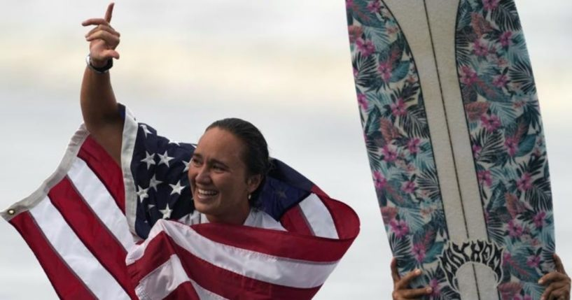 Surfer Carissa Moore celebrates during the Summer Olympics at Tsurigasaki in Ichinomiya, Japan, on July 27.