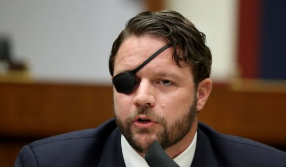 Texas Republican Rep. Dan Crenshaw questions witnesses during a hearing on Capitol Hill Sept. 17, 2020, in Washington, D.C.