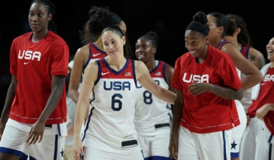 A photo taken on Friday shows athlete Sue Bird and her teammates at the semifinal in Serbia during the 2020 Summer Olympics.