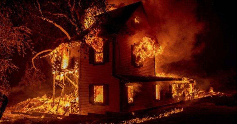 A home on Jeters Road in Janesville, California, is seen burning on Monday.