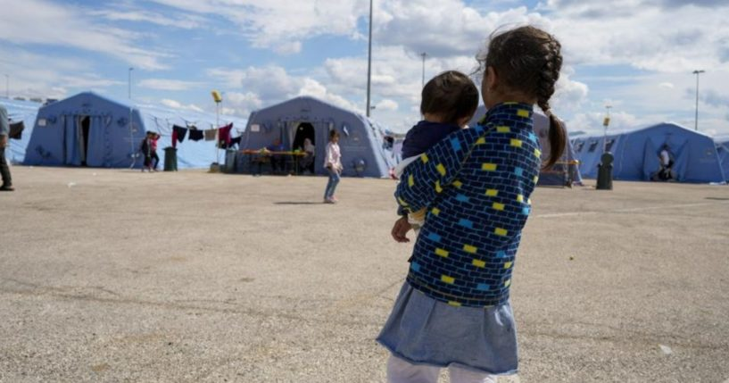 Afghan refugees are seen at an Italian Red Cross camp in Avezzano, Italy, on Tuesday.