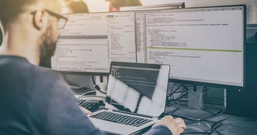 A web developer is pictured working at his computer in the stock image above.