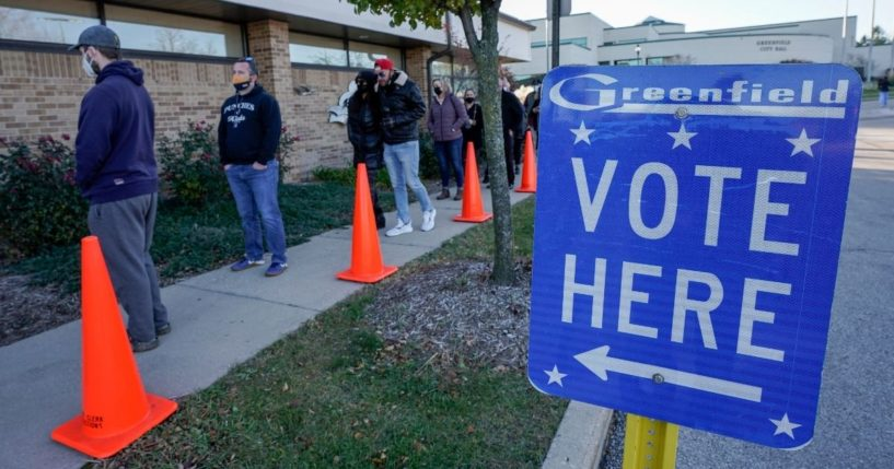 People line up to vote outside the Greenfield Community Center in the Milwaukee suburb of Greenfield, Wisconsin, on Nov. 3, 2020.