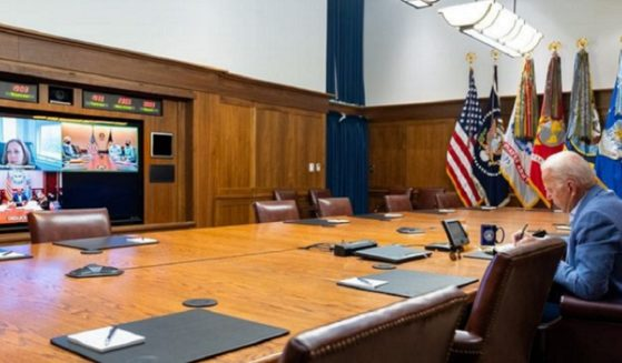President Joe Biden meets with top administration officials by teleconference in a photo released by the White House on Saturday.