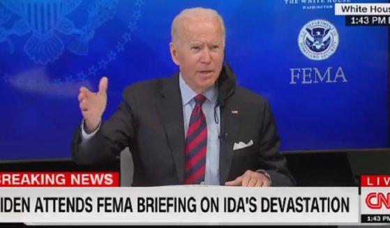 President Joe Biden gestures Monday while introducting senior advisor Cedric Richmond at a news conference.