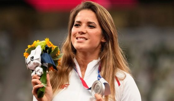 Silver medalist Maria Andrejczyk of Poland poses on the podium during the medal ceremony for the women's javelin at the Tokyo Olympics on Aug. 7, 2021, in Tokyo.