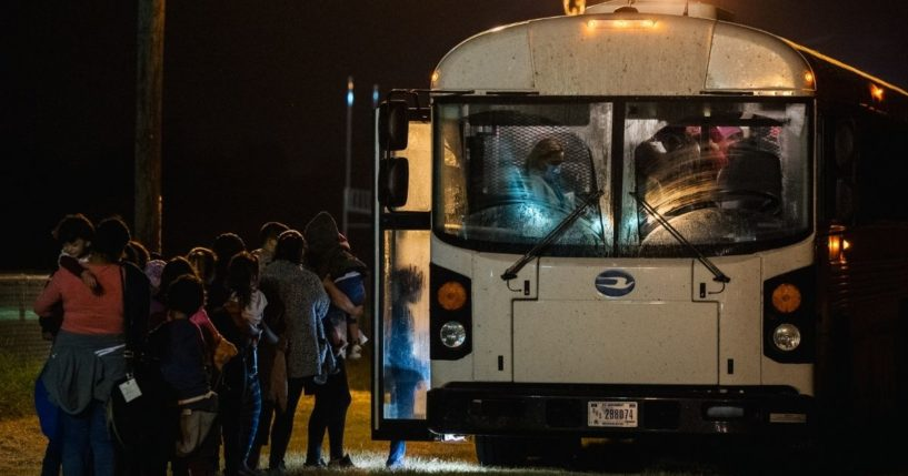 Migrants board a bus to be taken to a Border Patrol processing facility after crossing the Rio Grande into the U.S. on June 21, 2021, in La Joya, Texas.