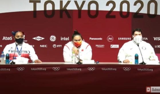 Olympic weightlifters Emily Campbell of Great Britain, left, Li Wenwen of China, center, and Sarah Robles of the United States, right.