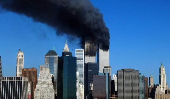 The twin towers of the World Trade Center billow smoke after hijacked airplanes crashed into them on Sept. 11, 2001.