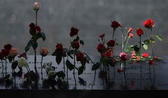 Flowers are placed into the inscribed names of the victims of the 9/11 attacks and in the 1993 World Trade Center bombing during the annual commemoration ceremony at the National 9/11 Memorial and Museum on Sept. 11, 2021 in New York City.