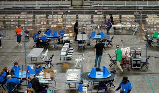 Maricopa County ballots cast in the 2020 general election are examined and recounted by contractors working for Florida-based company, Cyber Ninjas, on Thursday, May 6, 2021 at Veterans Memorial Coliseum in Phoenix.