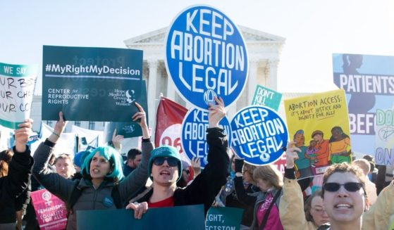 Pro-abortion activists protest outside the Supreme Court in Washington, D.C., on March 4, 2020.