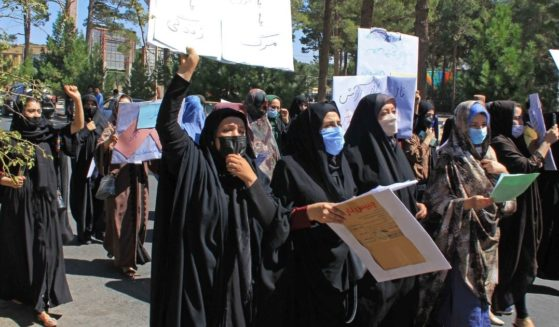 Afghan women hold placards as they take part in a protest in Herat on Thursday.