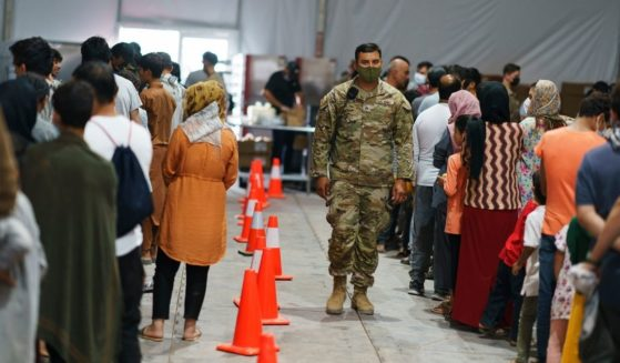 Afghan refugees line up for food in a dining hall at Fort Bliss' Doña Ana Village where they are being housed in Chaparral, New Mexico, on Friday.