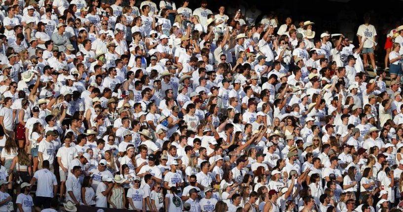 The crowd stands in the Texas A&M student section during the Aggies' game against the Kent State Golden Flashes at Kyle Field in College Station, Texas, on Saturday.