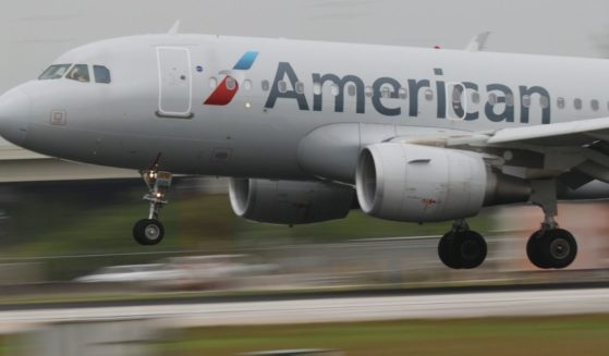 An American Airlines plane lands at the Miami International Airport on June 16, 2021, in Miami.