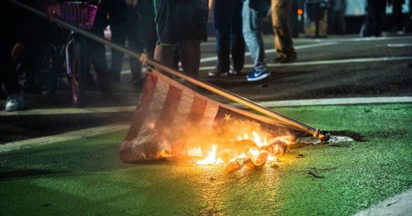 Protesters burn an American flag in Portland, Oregon, on Nov. 4, 2020, during a Black Lives Matter demonstration.