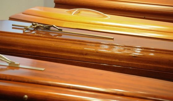 This stock image portrays a line of caskets in a funeral home. The audit of the 2020 election in Arizona reportedly found there were several hundred potential ballots counted from dead voters.