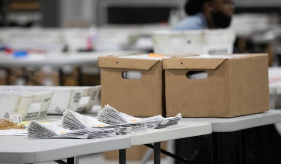 A stack of ballots is in the process of being counted at the Gwinnett Voter Registrations and Elections office on Nov. 6, 2020, in Lawrenceville, Georgia.
