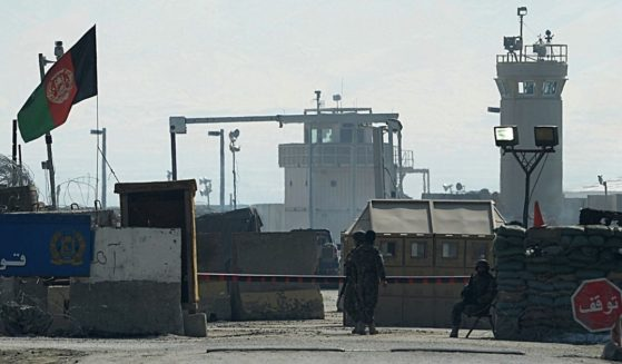 Afghan National Army soldiers stand guard at the Bagram prison gate on Feb. 13, 2014, in Afghanistan.