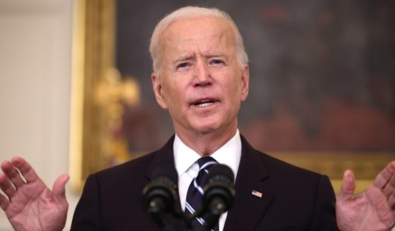 President Joe Biden speaks about combating the coronavirus pandemic in the State Dining Room of the White House on Thursday in Washington, D.C.