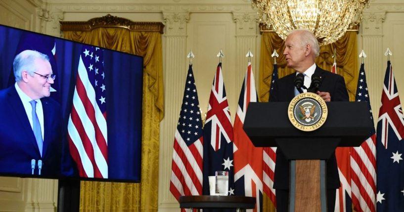 President Joe Biden, right, looks toward Australian Prime Minister Scott Morrison during a virtual news conference in the East Room of the White House in Washington on Wednesday.