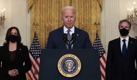 President Joe Biden delivers remarks while flanked by Vice President Kamala Harris (L) and Secretary of State Antony Blinken (R) in the East Room of the White House on Aug. 20, 2021 in Washington, D.C.