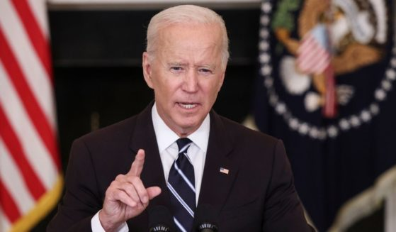President Joe Biden speaks about his new orders to fight the coronavirus pandemic in the State Dining Room of the White House in Washington on Thursday.