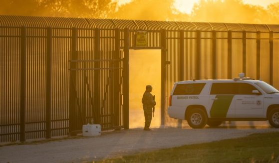 A Border Patrol vehicle drives through a gate in the border fence after U.S. Customs and Border Protection closed the point of entry between the U.S. and Mexico in response to an influx of migrants on Sept. 17, 2021, in Del Rio, Texas.