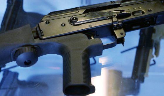 A bump stock is seen attached to a semi-automatic rifle at the Gun Vault store and shooting range in South Jordan, Utah, on Oct. 4, 2017.