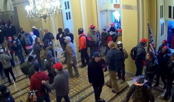 People mill out the Capitol after entering the building on Jan. 6.