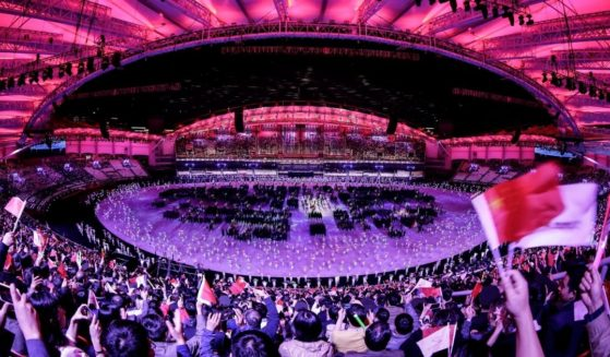 Fans cheer during the opening ceremony of the 7th International Military Sports Council (CISM) Military World Games in Wuhan, capital of central China's Hubei Province.
