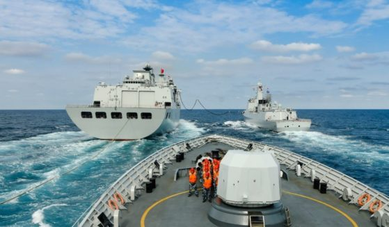 Warships attached to a Chinese navy destroyer flotilla perform replenishment-at-sea during a four-day combat training exercise in the South China Sea.
