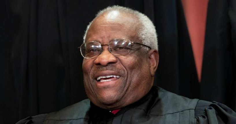 Supreme Court Associate Justice Clarence Thomas sits with fellow Supreme Court justices for a group portrait at the Supreme Court Building in Washington, D.C., in 2018.