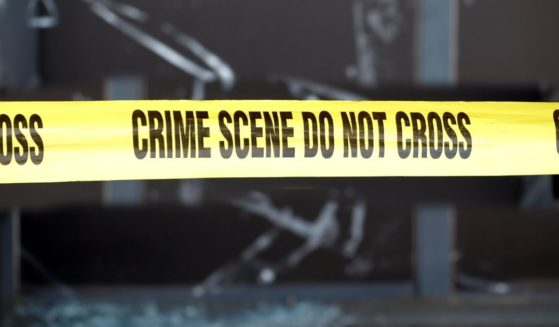 A crime scene with police tape is pictured in the stock image above.