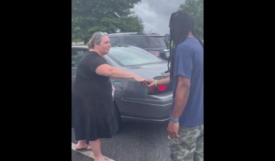 Chris Jackson, right, the head custodian at Unity Grove Elementary School in Locust Grove, Georgia, is given a car.