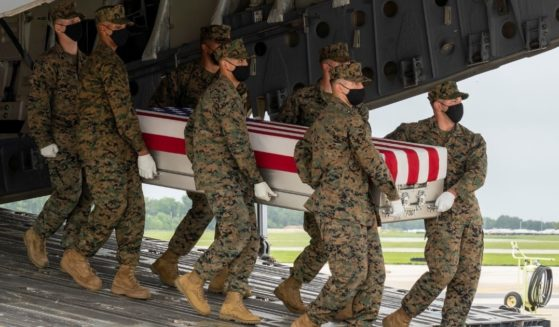 A U.S. Marine Corps carry team transfers the remains of Marine Corps Cpl. Humberto A. Sanchez on Aug. 29, 2021, at Dover Air Force Base, Delaware.