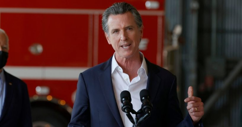 California Gov. Gavin Newsom speaks after a helicopter tour of the Caldor Fire, at Mather Airport on Sept. 13, 2021, in Mather, California.