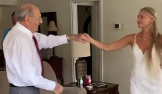Natalie Browning flew 800 miles with her wedding dress to share a dance with her 94-year-old grandfather.