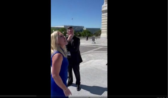 Georgia Rep. Marjorie Taylor Greene shouted her support for the unborn Friday as Democrats gathered on the Capitol steps to celebrate passage of a measure calling for unrestricted abortion up until birth.