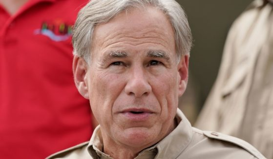 Texas Gov. Greg Abbott speaks during a news conference along the Rio Grande in Del Rio on Tuesday.