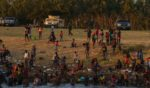 Haitian migrants are pictured on the banks of the Rio Grande in Del Rio, Texas, as seen from Ciudad Acuna, Coahuila state, Mexico, on Monday.