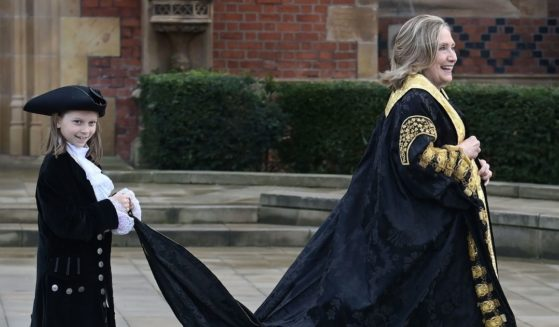 Former Secretary of State Hillary Clinton takes part in an official procession at Queens University on Friday in Belfast, Northern Ireland.